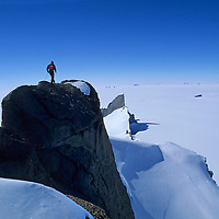 ANTARCTICA, Queen Maud Land.  Rick Ridgeway (MR) atop satellite peak of the Troll's Castle, Filchner Mountains.
