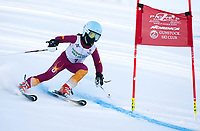 Madeleine Baron races in the U10 division of the annual Gus Pitou memorial giant slalom race with the Gunstock Ski Club on Sunday.  (Karen Bobotas/for the Laconia Daily Sun)
