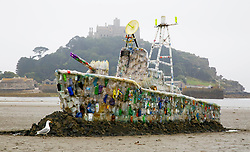 EDITORIAL USE ONLY<br /> A 30ft model of a warship, which is made entirely of plastic marine litter is unveiled on Marazion Beach in Cornwall by campaign group Surfers Against Sewage, to highlight the growing threat of throwaway plastic in the seas and encourage the public to reduce their single-use plastic footprint.