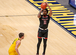 Jan 25, 2021; Morgantown, West Virginia, USA; Texas Tech Red Raiders guard Kyler Edwards (11) shoots a three pointer over West Virginia Mountaineers guard Jordan McCabe (5) during the first half at WVU Coliseum. Mandatory Credit: Ben Queen-USA TODAY Sports