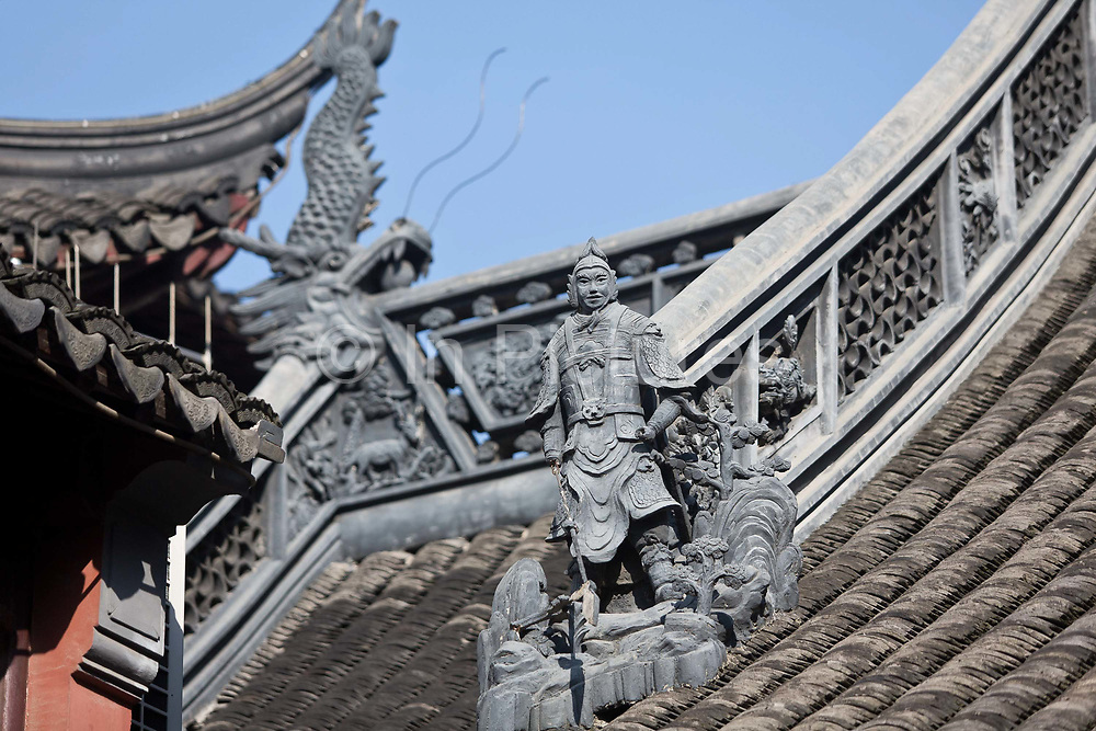 Old Town ShanghaiAn intricate statue of a Chinese general adron the tip of the tiled roof at Chenghuangmiao (City God) Temple in Shanghai, China on 13 October 2013. Yuyuan and the surrounding Chenghuangmiao area represent the oldest vestige of Shanghai, having existed long before the British made Shanghai a treaty port and the most important economic hub in China.