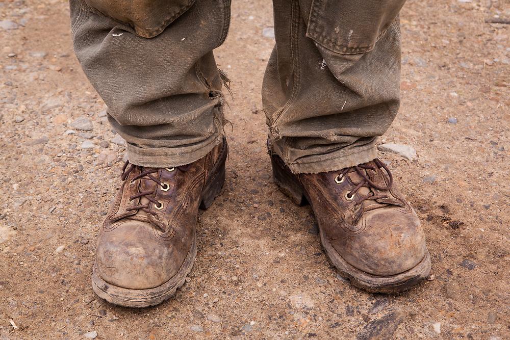 A farmer's well-worn boots.