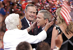 United States President George W. Bush reaches into his mother, Barbara Bush's arm as his dad, former President George H.W. Bush looks on with a smile, at Madison Square Garden during the Republican National Convention on Thursday, September 2, 2004. Photo by Chuck Kennedy/KRT/ABACA.  | 65187_04