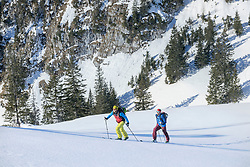 Skiers climbing on snowcapped mountain