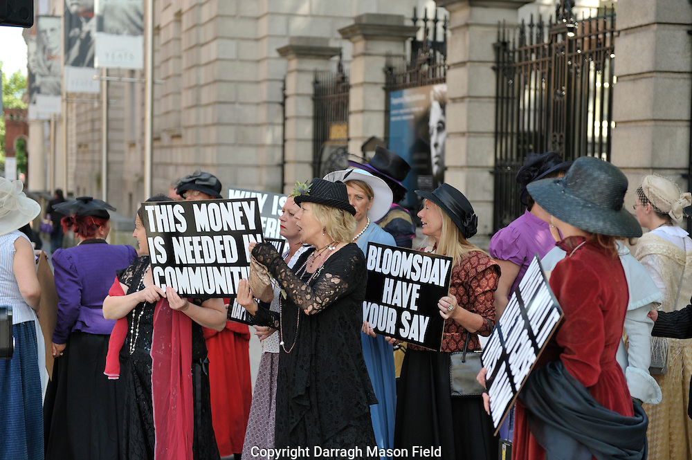 Bloomsday protesters in costume protest against the Banks outside Dáil Éireann