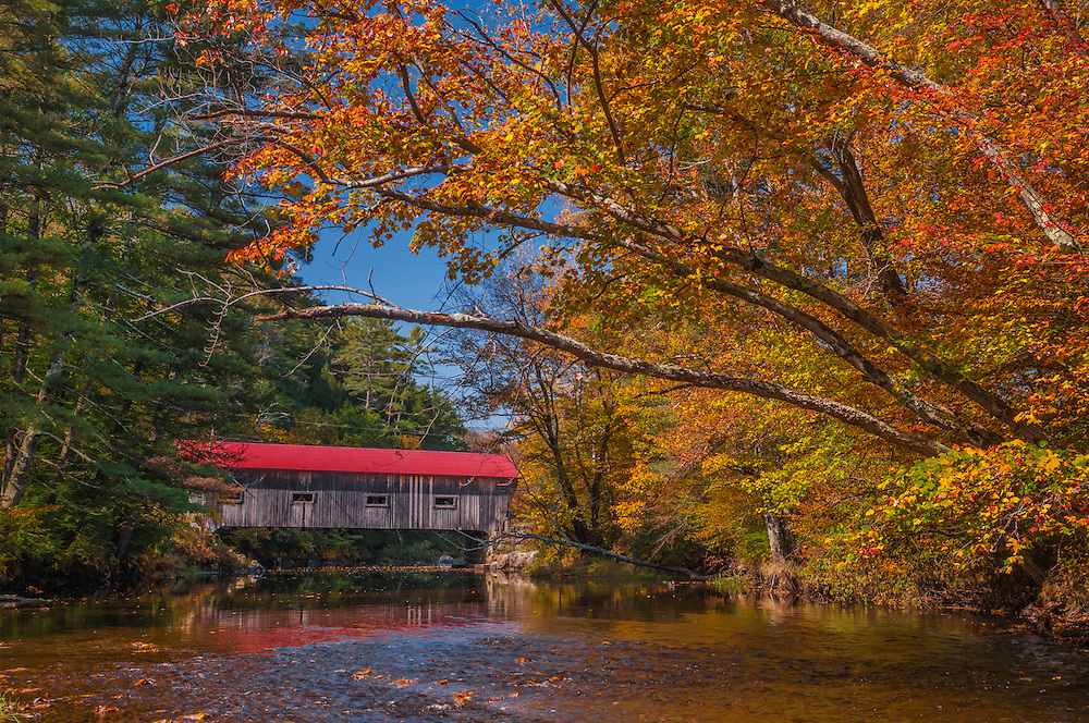Dalton Covered Bridge framed by fall foliage branches, built in 1853 for $630, Joppa Road, spanning the Warner River, Warner, NH