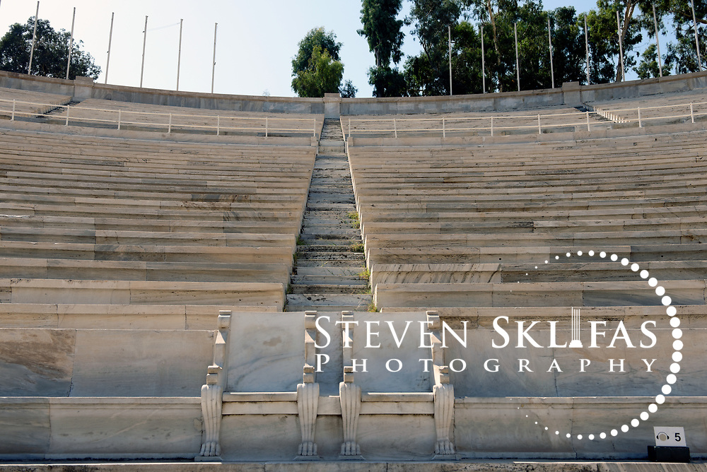 Panathenaic stadium. Athens. Greece. View of the Royal boxes (seats) used in 1896 located at the curved end of the stadium. The Panathenaic (Kallimarmaro) stadium was used for the first international Olympic games of the modern era in 1896.  The completely marble stadium occupies the exact site of the original, built in 330BC which was used for the ancient Panathenaic games (part of the larger religious festival, the Panathenaia).