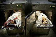 Bodies of Kaldon Abu Jarad, left, and an unidentified Palestinian teenager, right, are placed in a morgue at Al-Shifa Hospital in Gaza City after the clash between Israeli tanks and the youths in Beit Lahia, near Jewish settlements.