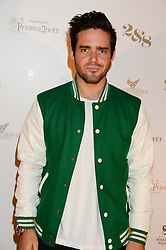 SPENCER MATTHEWS at a party to celebrate the 1st birthday of nightclub 2&8 at Mortons held in Berkeley Square, London on 3rd October 2013.