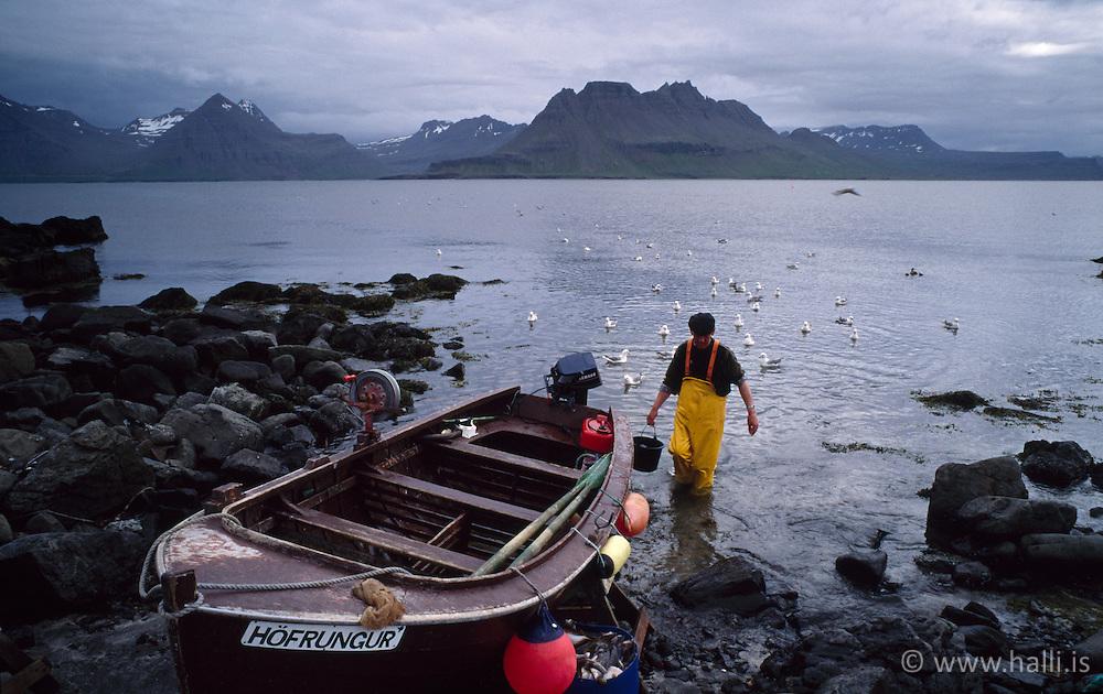Sjómaður við trillu á Gjögri - Fisherman at his small boat in Gjogur, Iceland