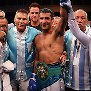 Luis Carlos Abregu celebrates after defeating Thomas Dulorme for the WBC International title during the HBO Triple Explosion fight at the Turning Stone Resort Casino in Verona, NY, on Saturday, Oct 27, 2012.  Abregu won the bout by TKO in the 7th round.(AP Photo/Alex Menendez)
