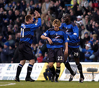 Photo. Glyn Thomas.<br /> Gillingham v Charlton. FA Cup Third Round.<br /> Priestfield Stadium. 03/01/2004.<br /> Gillingham's first goalscorer Tommy Johnson (L) congratulates Mamady Sidibe (R) on scoring Gillingham's second goal with Danny Spiller.