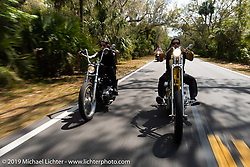 Kissa Von Adams on her custom Evo chopper riding with Xavier Muriel riding a Little Twisted, the Twisted Tea Panhead built by Cycle Source Magazine through Tomoka State Park during Daytona Bike Week. FL. USA. Sunday March 18, 2018. Photography ©2018 Michael Lichter.