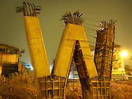 Pillars of a new bridge form a W shape during construction, intersection of Van Cao and Hang Hoa Tam in Ba Dinh District, Hanoi, Vietnam, Southeast Asia