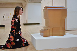"""© Licensed to London News Pictures. 11/09/2017. London, UK. A staff member views """"Untitled (Hive) II"""", 2001, at the preview of an exhibition featuring works by artist Rachel Whiteread at Tate Britain.  The exhibition spans her career over three decades and runs 12 September to 21 January 2018.   Photo credit : Stephen Chung/LNP"""