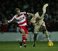 Photo: Aidan Ellis.<br /> Doncaster Rovers v Bristol City. Coca Cola League 1.<br /> 26/11/2005.<br /> Bristol's Baz Savage holds off Doncaster's Ricky Ravenhill