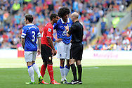 Referee Anthony Taylor tries to calm down Everton's Marouane Fellaini & Cardiff's Fraizer Campbell.  Barclays Premier league, Cardiff city v Everton at the Cardiff city Stadium in Cardiff,  South Wales on Saturday 31st August 2013. pic by Andrew Orchard,  Andrew Orchard sports photography,