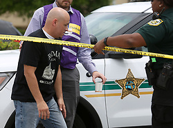 June 5, 2017 - Orlando, FL, USA - A coworker arrives at a staging center setup by the Orange County Sheriff's Office on Forsyth Road, following an office shooting that killed 5 in Orlando, Fla., Monday, June 5, 2017. (Credit Image: © Joe Burbank/TNS via ZUMA Wire)