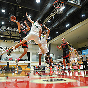 Biola guard Michael Bagatourian (0) shoots the ball with pressure from Concordia forward Kayle Knuckles (14) and Concordia forward Rob McCoy (2) during the PacWest Basketball Tournament in Felix Event Center at Azuza Pacific University on March 5, 2020 in Azuza, California, USA. Mandatory credit: Peter Alexander / Sports Shooter Academy