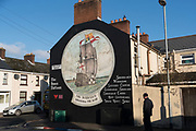 Bonds Street Loyalist area with many loyalist murals about the British Military machine, with images depicting and glorifying  destroyers, tanks and other weapons of war are on display. It is a staunch unionist area, fiercely pro-Britain. Their representatives, the Democratic Unionist Party, founded by Ian Paisley in 1971, are presently in parliament in collusion with the conservative party, looking for a hard Brexit with a border between Northern Ireland and the South. The ten DUP votes gives the conservative party its majority in government. This is nothing new. During the 'Troubles' three decades of bloodshed, with Catholic Irish Republican Nationalists seeking to unit Ireland, the pro-British Protestant loyalists wanted to remain part of the United Kingdom.