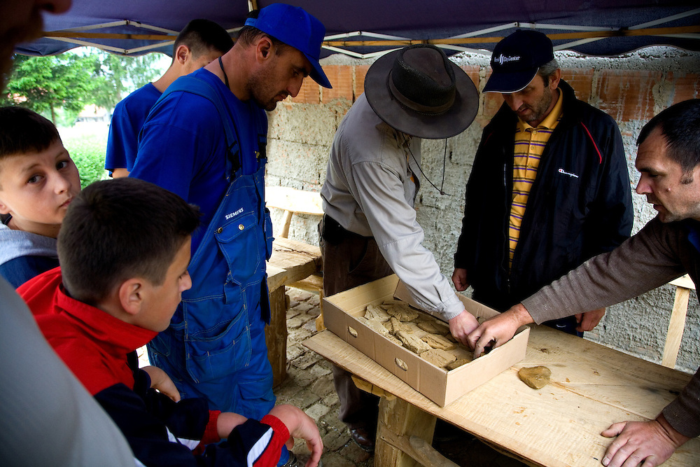 """Semir Osmanagic meets with colleagues and locals in a settlement near the base of the Moon Volcano. They were examining some castings found nearby the previous week...Bosnian Pyramids.Visoko, Bosnia and Herzegovina. **The authenticity of the """"Bosnian Pyramids"""" has been a point of heated debate in the scientific community**"""