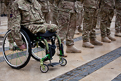 © Licensed to London News Pictures. 04/11/2012. London, UK. 25 year old Territorial Army soldier lance corporal John Wilson (L) is seen parading with Vimy Company, the London Regiment, at Guildhall in London today (04/11/12). Lance Corporal Wilson lost both legs to an improvised explosive device (IED) in Afghanistan on July 4th 2012. The 52 reservists of Vimy Company, who come from all walks of life, paraded at Guildhall to be presented with their Operational Service Medals after returning from operations in Afghanistan.  Photo credit: Matt Cetti-Roberts/LNP