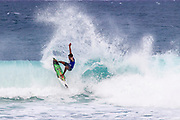 Robert Grilho of Hawaii advances in 1st to round 2 from round 1 heat 3 of the Volcom Pipe Pro held at Pipeline, Oahu, Hawaii.