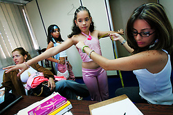 articipants in the Mini Modelo beauty pageant get their measurments taken.  The pageant is for girls aged 6-10. Beauty pageants for little girls are fairly common and very accepted in Venezuela. Girls aged 6-10 often spend months or years taking all sorts of beauty school classes, ranging from runway walking to makeup to etiquette. The families spend thousands of dollars on preparing their girls for the pageants ; they have to pay for beauty school classes, a competition entrance fee, dresses and many other expenses.  The world of beauty pageants is said to be very corrupt, where the highest bidder is the surest winner.