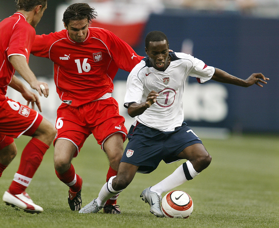 Soccer- USA vs Poland.USA's DaMarcus Beasley (7), right.
