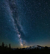 The Milky Way is visible in the midnight sky over the eastern flank of Mount Rainier in Washington state. The Milky Way is the galaxy that contains our solar system and is comprised of as many as 400 billion stars and 100 billion planets. Its name comes from the appearance of a band of stars that from Earth are so close together that they cannot be distinguished as individual stars with the naked eye. Mount Rainier, which has a summit of 14,411 feet (4,392 meters), is the highest mountain in Washington state and largest volcano in the Cascade Range. This view was captured from Sunrise in Mount Rainier National Park.