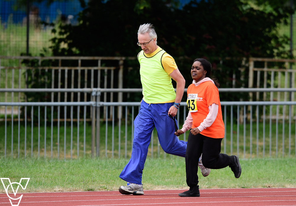 Event: 200 meters<br /> Competitors, from left: Destiny Ntumy-Kamara<br /> <br /> Metro Blind Sport's 42nd Athletics Open, held at Mile End Stadium, Tower Hamlets, London.<br /> <br /> Picture: Chris Vaughan Photography for Metro Blind Sports<br /> Date: June 16, 2018