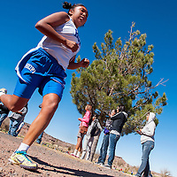 110213       Cable Hoover<br /> <br /> Hopi Bruin Claryn Josytewa fights to hold on to her second place spot in the final minutes of the division 4 race of the Arizona sectional cross country meet in Holbrook Saturday. Josytewa finished in third place.