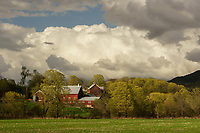 Dramatic cumulous clouds over farm during springtime in the Mad River Valley, Vermont