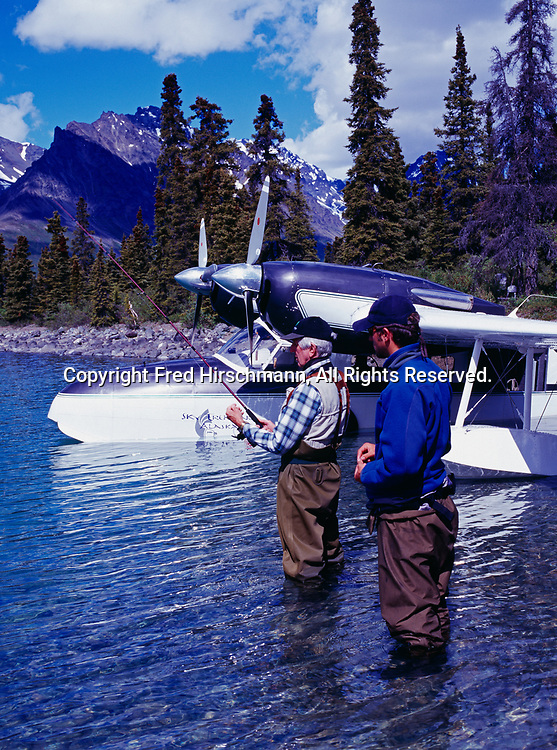 Guest Bobby Connors and guide Josh Fitz fishing for lake trout at Dick Proenneke's cabin site on upper Twin Lake, Sky Trekking Alaska's Grumman Widgeon, Lake Clark National Park, Alaska.  (MR)