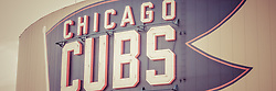 Chicago Cubs sign vintage panoramic picture. Panorama photo ratio is 1:3 and has a retro tone. The Chicago Cubs sign is on Wrigley Field which is a Chicago landmark baseball field that was built in 1914 and is home to the Chicago Cubs Major League Baseball team.