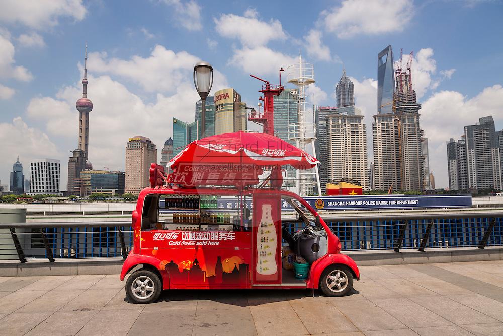 A vendor sells Coke along the Bund promenade Shanghai, China