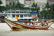 18 JUNE 2013 - YANGON, MYANMAR:  A river taxi crosses the Yangon River in Yangon. Many working class Burmese live on the far side of the river and the boats to commute to and from work every day.      PHOTO BY JACK KURTZ