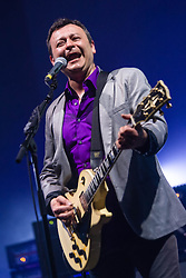 © Licensed to London News Pictures. 11/04/2014. London, UK.   Manic Street Preachers performing live at Brixton Academy.  In this picture - James Dean Bradfield.  Manic Street Preachers are a Welsh alternative rock band consisting of James Dean Bradfield (lead vocals, lead guitar), Nicky Wire (bass guitar, lyrics) and Sean Moore (drums).  Photo credit : Richard Isaac/LNP