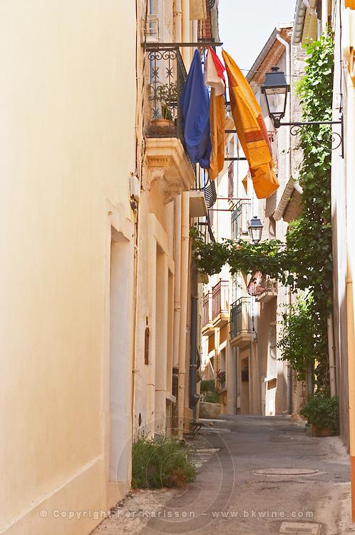 Narrow village street. Bouzigues Languedoc. France. Europe.