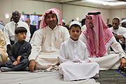 "Sept. 10 - GLENDALE, AZ:  Muslim men gather in the Glendale Civic Center in Glendale, before Eid ul-Fitr services. Muslims from the Phoenix area celebrated Eid ul-Fitr, the end of Ramadan, at the Glendale Civic Center in Glendale, AZ, a suburb of Phoenix. Eid ul-Fitr, often abbreviated to Eid, is the Muslim holiday that marks the end of Ramadan, the Islamic holy month of fasting. Eid is an Arabic word meaning ""festivity"", while Fitr means ""conclusion of the fast""; and so the holiday symbolizes the celebration of the conclusion of the month of fasting from dawn to sunset during the entire month of Ramadan. The first day of Eid, therefore, is the first day of the month Shawwal that comes after Ramadan.  Photo by Jack Kurtz"