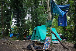 Denham Protection Camp, which has been established by environmental activists from HS2 Rebellion to try to hinder or prevent work for the HS2 high-speed rail link, on 13th July 2020 in Denham, United Kingdom. The HS2 project is currently projected to cost around £106bn and will remain a net contributor to CO2 emissions during its projected 120-year lifetime.