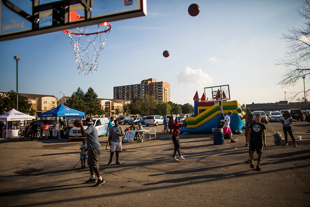 Mississauga , Ontario - August 19, 2015 -- Basketball -- Kids play on a temporary basketball court set up by the Erin Mills Youth Centre during a community event in a parking lot in Mississauga, Thursday August 19, 2015   (Mark Blinch for the Globe and Mail)