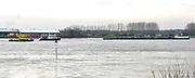Nederland, Millingen aan de Rijn, 6-1-2018De tanker Noortstroom is vastgelopen op een krib, en wordt later losgetrokken door een sleepboot. Brandweerboot en rijkswaterstaat houden een oogje in het zeil.Foto: Flip Franssen