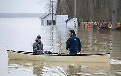 Two men use a canoe to move along the Hudson-Oka ferry loading ramp in the town of Hudson, Quebec, Canada., west of Montreal, Monday, May 8, 2017, following flooding in the region. Photo by Graham Hughes /The Canadian Press/ABACAPRESS.COM