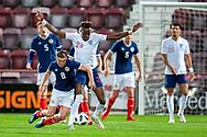 Tammy Abraham (#23) of England U21s (Aston Villa, loan from Chelsea) fouls Allan Campbell (#8) of Scotland U21s (Motherwell FC) during the U21 UEFA EUROPEAN CHAMPIONSHIPS match between Scotland and England at Tynecastle Stadium, Edinburgh, Scotland on 16 October 2018.