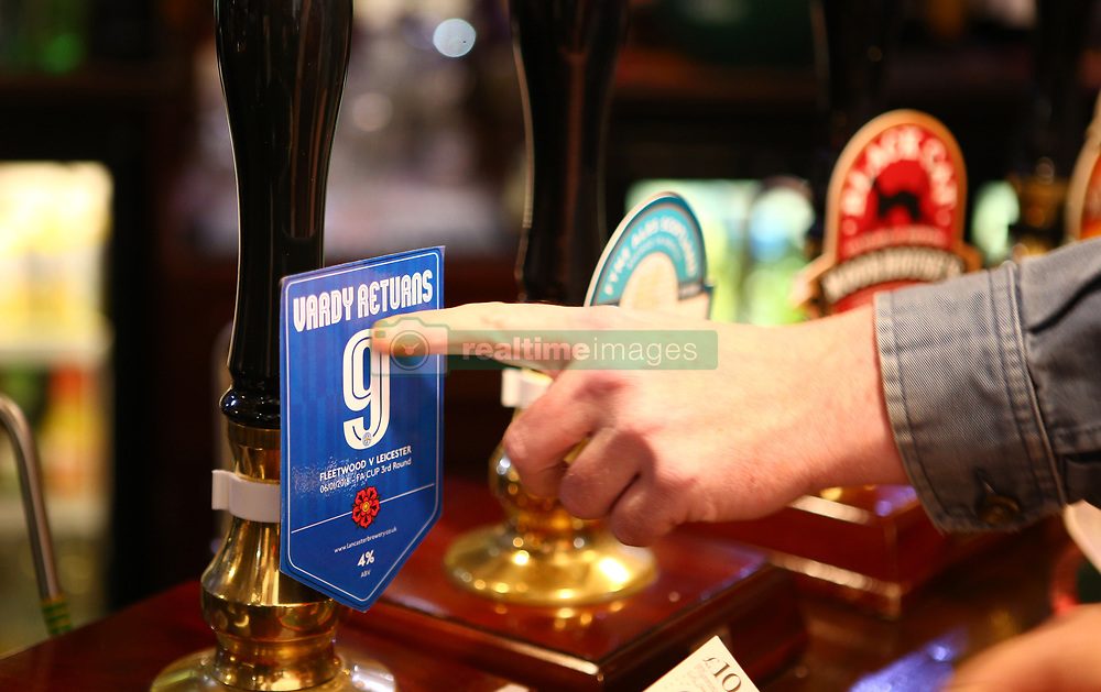 A fan orders a pint of 'Vardy Returns' at the Strawberry Gardens Pub before the FA Cup, third round match at Highbury Stadium, Fleetwood