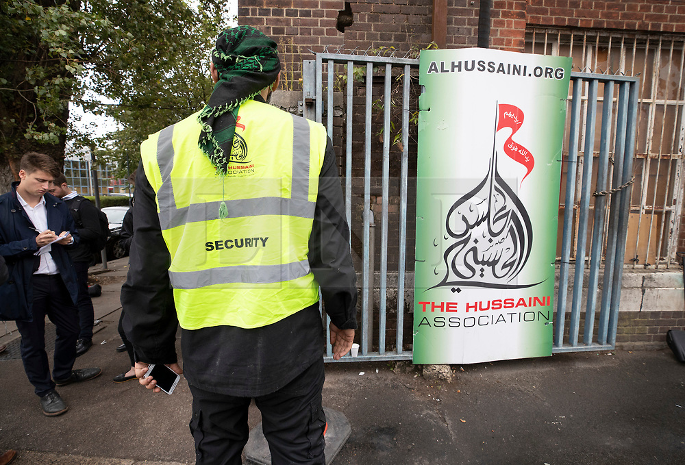 © Licensed to London News Pictures. 19/09/2018. London, UK. A private security guard talks with reporters (L) at the entrance to The Hussaini Association Islamic Centre in Cricklewood, north London where a car hit two pedestrians last night. The incident , which took place in the early hours of this morning outside the centre, is being treated as a possible hate crime. Police are looking for a male driver who failed to stop at the scene, as well as two men and one woman in the car, all in their 20s. Photo credit: Peter Macdiarmid/LNP