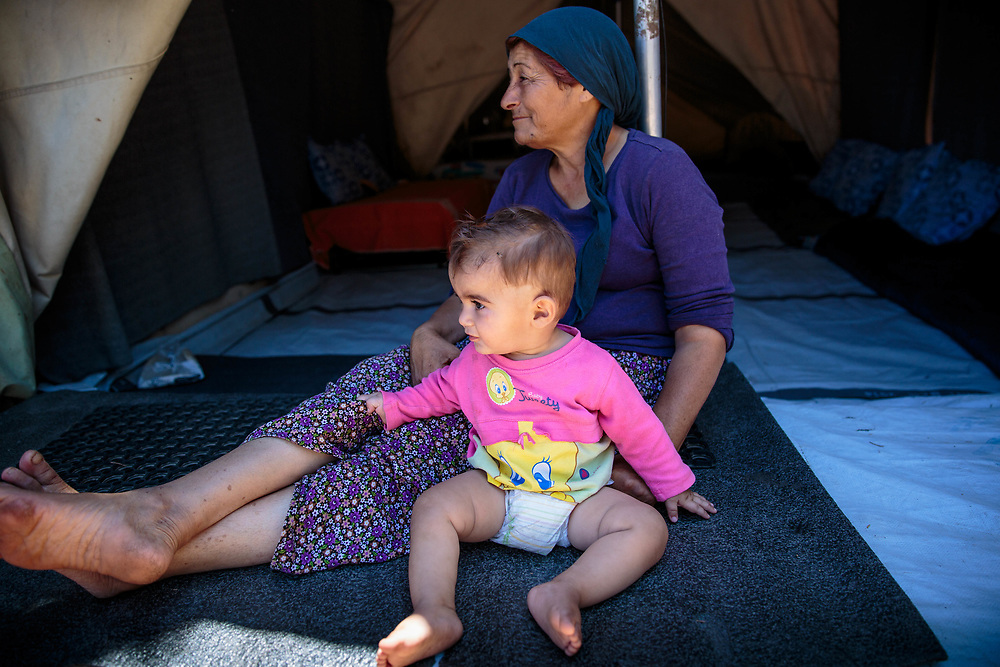 2016 July-Ritsona Refugee Camp, Ritsona, Greece. Afadee and her grandson, Deyar, 1, are Syrian Kurdish refugees from Aleppo, Syria.  They and their extended family have been living in Ritsona for four months.