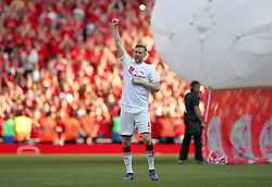 Arsenal's Per Mertesacker salutes the fans after his final home appearance for the club during the Premier League match at the Emirates Stadium, London.