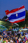 03 JANUARY 2014 - BANGKOK, THAILAND: Anti-government protestors at Democracy Monument. Thousands of Thai anti-government protestors came to Democracy Monument in Bangkok Friday night to hear Suthep Thaugsuban, the leader of the protests, announce his plans to shut down the city of Bangkok. Suthep said his protestors would occupy 20 major intersections in the commercial sections of Bangkok for up to three weeks or until the caretaker government of Yingluck Shinawatra resigns.     PHOTO BY JACK KURTZ